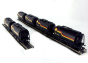Hornby R6371 Pack of Six Petrol Tanker Wagons in Shell Black on Track